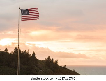 American flag waving at sunset in Trinidad, California, USA