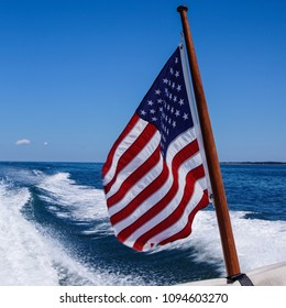 American Flag Waving in Wind with Boat Wake Behind