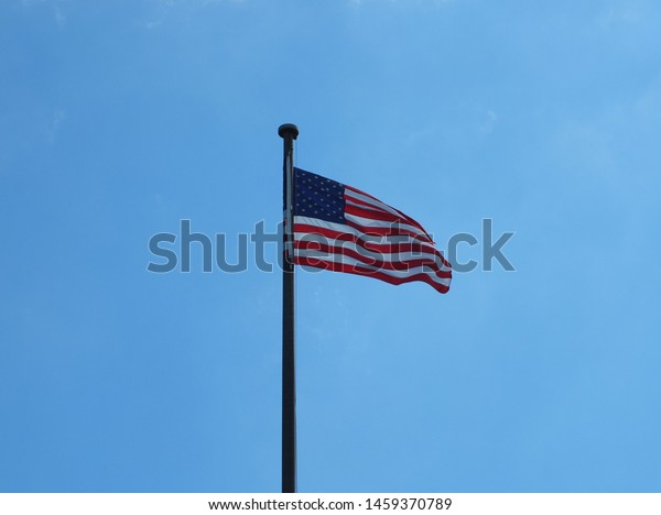 An American flag in the wind.