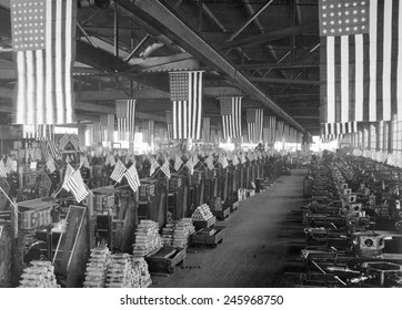 American flags decorate the machine shop for 3 inch artillery shells at the Bethlehem Steel Company during WWI. Ca. 1918.