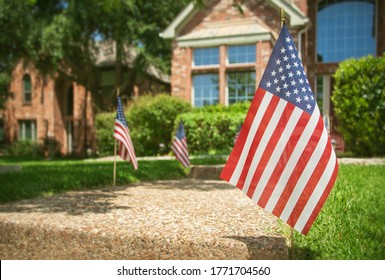 American flags displayed in the front of a southern home in honor of the 4th of July
