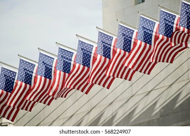 American Flags fluttering in front of Los Angeles City Hall.