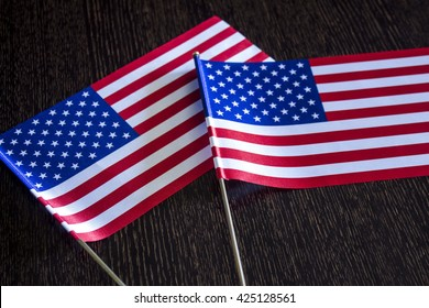 American flags on a dark background