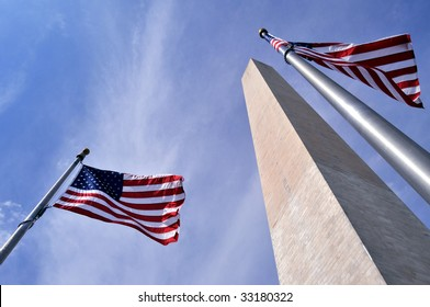 American flags surrounding the Washington Memorial on the National Mall in Washington DC.