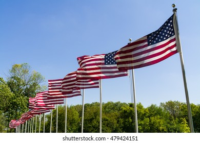 American flags waving in the afternoon sun.