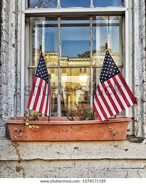 american flags in window