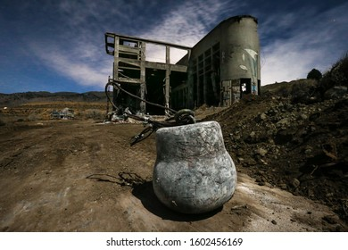 American Flat, Nevada - November 2014: A wrecking ball sits beside the remains of the United Comstock Merger Mill during demolition at the site of American Flat.