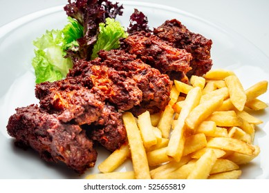 American food, close up food restaurant menu chicken wings with lettuce, french fries on white plate, restaurant concept, space for text