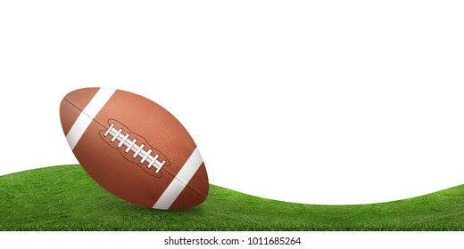 American football ball and green grass hill background isolated on white.