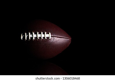 American football ball isolated on black background