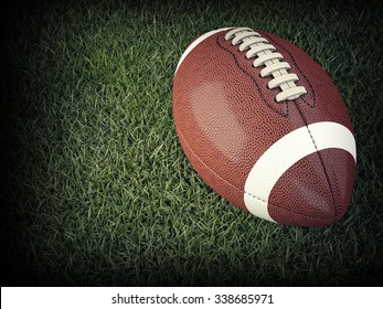 american football ball on grass