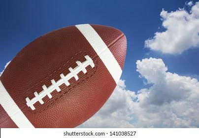 American football in blue sky