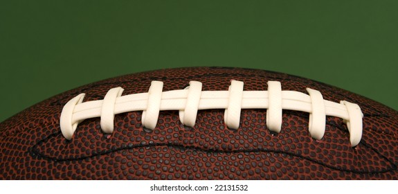 An American football with close up on laces