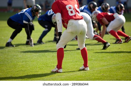 american football game with out of focus players in the background - sports concept
