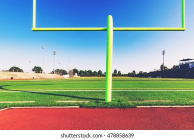 American football goal post in an outdoor sports stadium