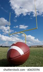 American Football with the goal posts or uprights in the background