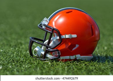 American football helmet at the artificial grass playing field