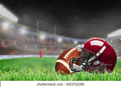 American football helmet and ball on field grass in brightly lit outdoor stadium with focus on foreground and shallow depth of field on background. Deliberate lens flare and copy space.
