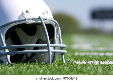 American Football Helmet Close Up on the Field with room for copy