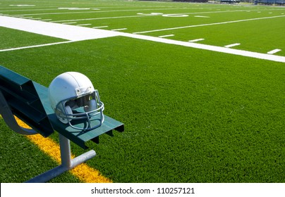 American Football Helmet on the Bench with the field beyond