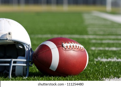 American Football and Helmet on the Field with room for copy