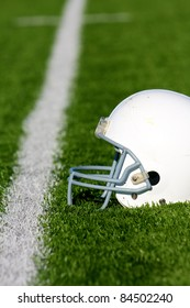 American Football Helmet on the Field with shalow depth of field and room for copy