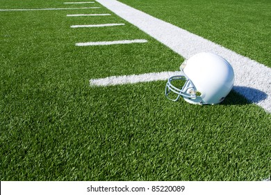 American Football Helmet on the Field with yard lines beyond