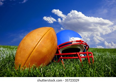 American Football and Helmet on a painted field with a bright blue background.