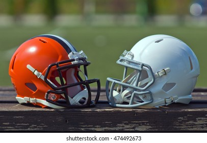 American football helmets at the artificial grass playing field