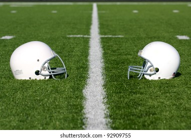 American Football Helmets on the Field with room for copy