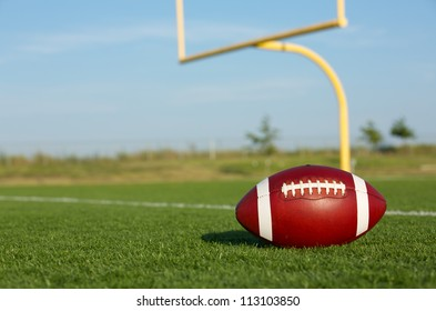 American Football on the Field with Goal Posts beyond