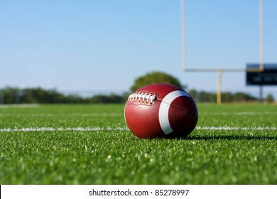 American Football on the Field with the Goal Posts beyond