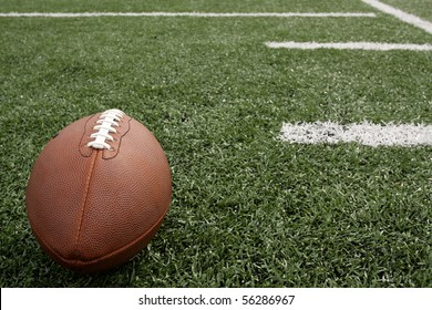 American Football on the field near yard lines