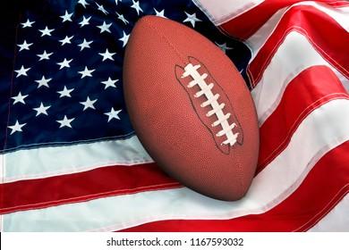 American football on American flag, old glory.