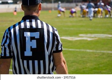 American Football played by young men with game official field judge referee