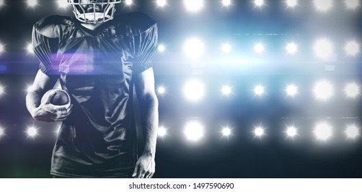 American Football Player against digitally generated image of blue spotlight