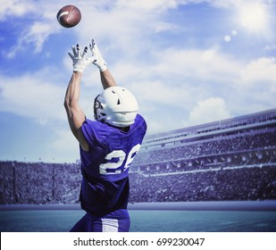 American Football Player Catching a touchdown Pass in a large stadium.
