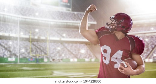 american football player celebrating touchdown on big modern stadium field with lights and flares