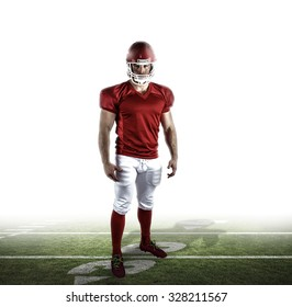 American football player looking at camera against american football pitch