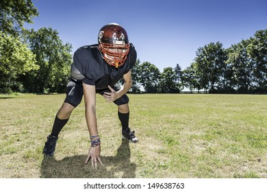 American football player offensive Lineman in in action at three point stance