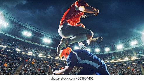 American football player over-jumps the opposite team player. He holds a a ball in his hands. Arena and people on it are made in 3D.