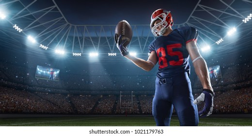 American football player performs an action play on professional sport stadium