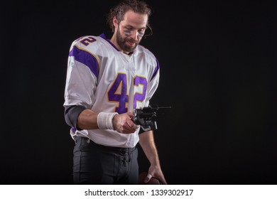 American football player posts a message to social networks using a mobile phone on the stabilizer.