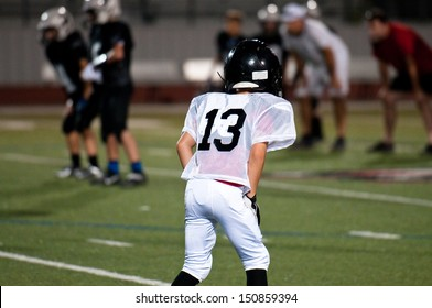 American football player in ready position.
