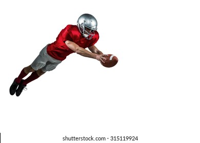 American football player scoring a touchdown on white background