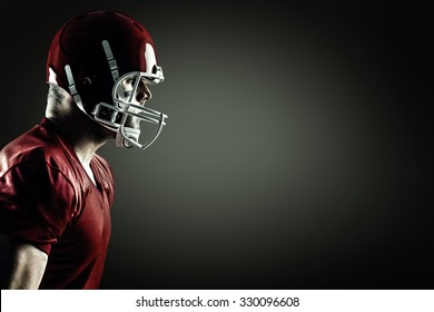 American football player side profile against green background with vignette