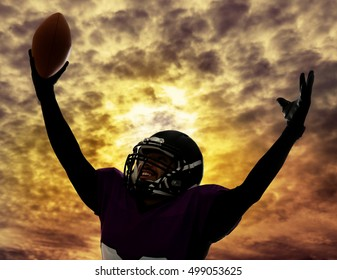 American football player silhouette on sky with clouds background