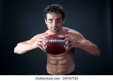 American Football Player with Sweat on Black Background