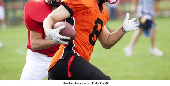 American football players fighting for the ball