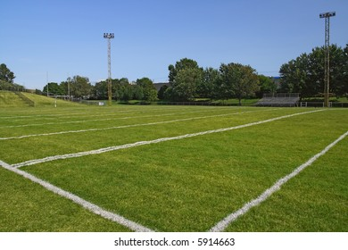 American football playing field under blue sky.